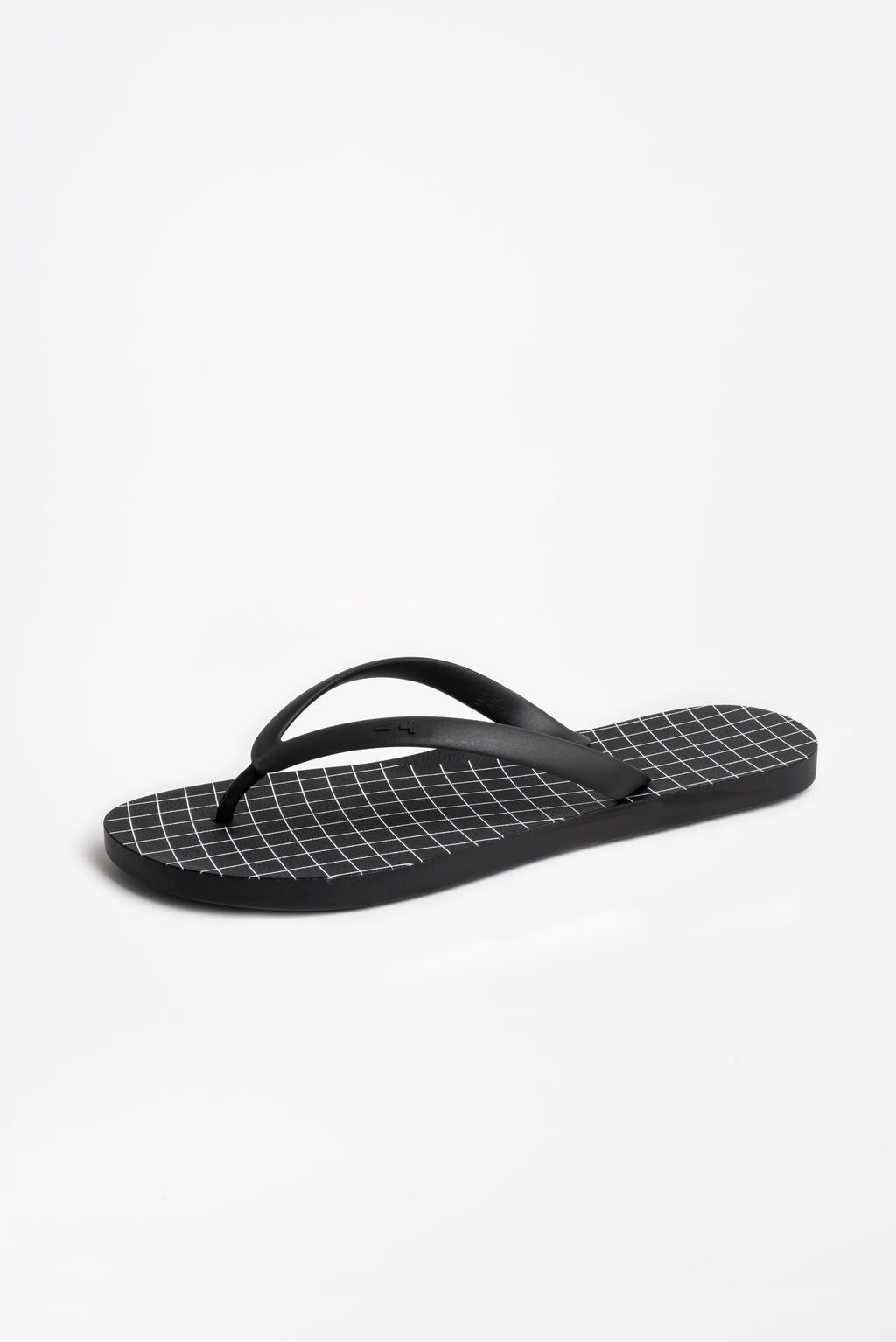 Grid design black flip flops for men. Sustainably made in America.