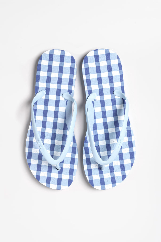Women's flip flops in deep sky blue with checker pattern