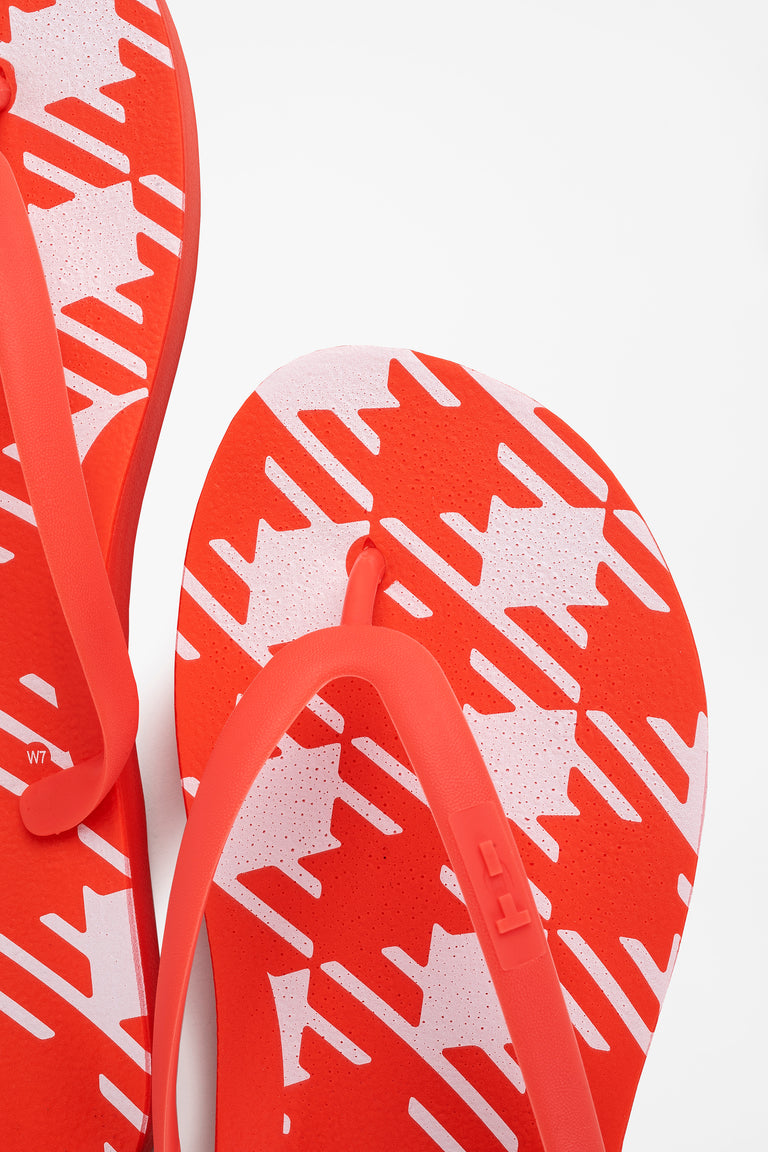 Red women's flip flops made in America