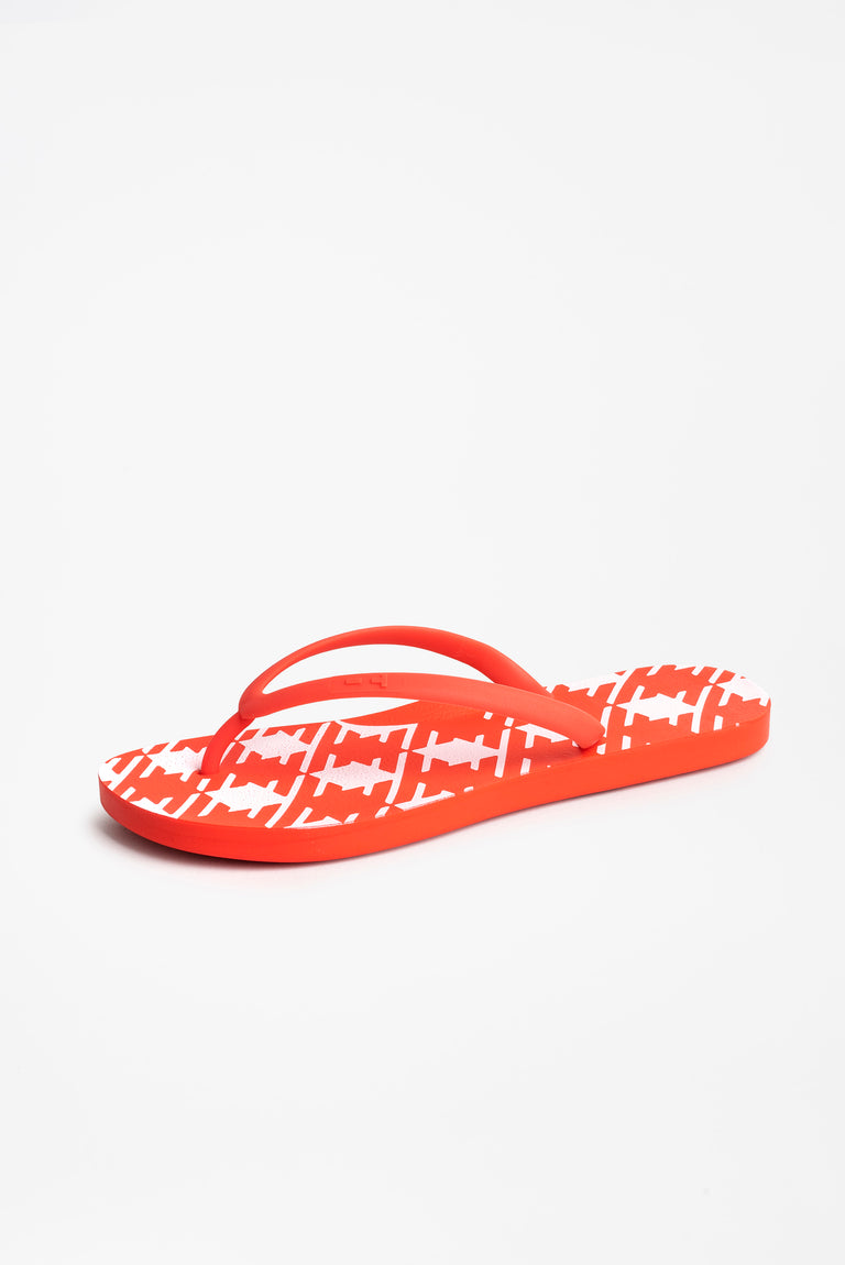 Side view of women's red flip flops with white checked pattern