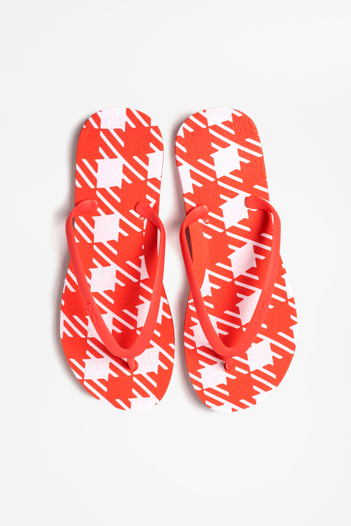 Comfy women's flip flops in red and white checked pattern
