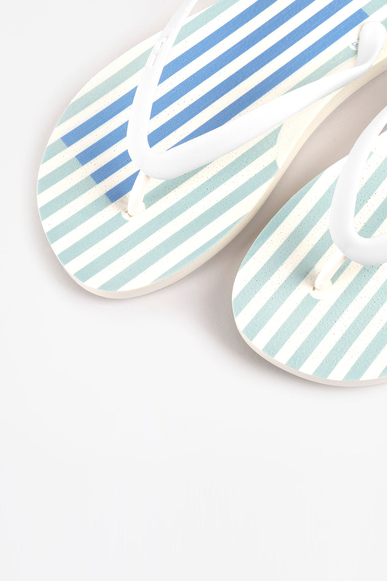 Green striped flip flops made with recycled materials