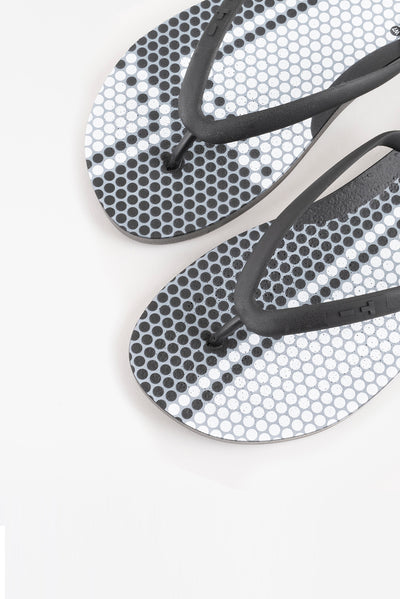 Tile pattern flip flops that are made in America.