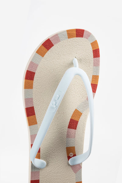 Nude flip-flops with tile border