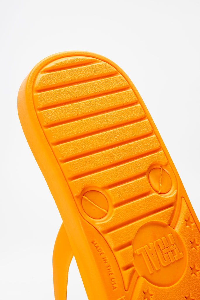 Sustainably made orange flip flops for men