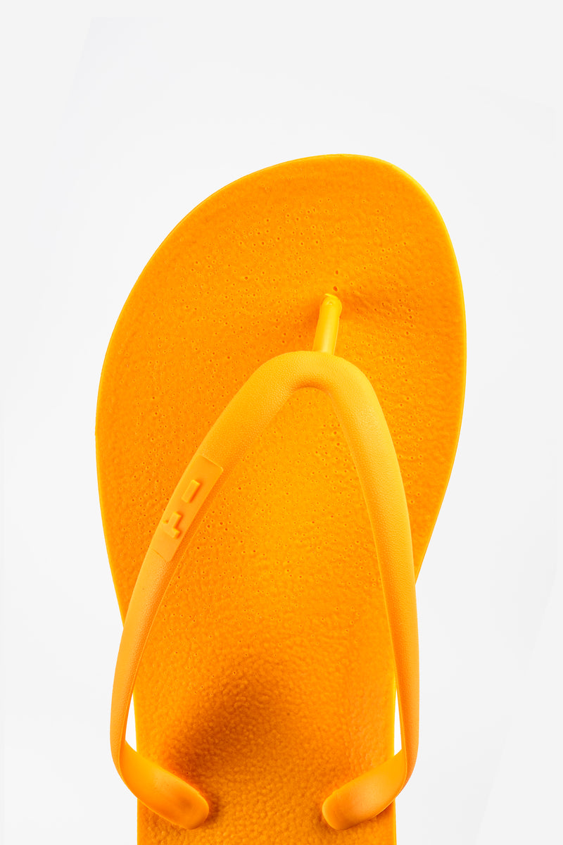 Orange flip flops for women made in the USA