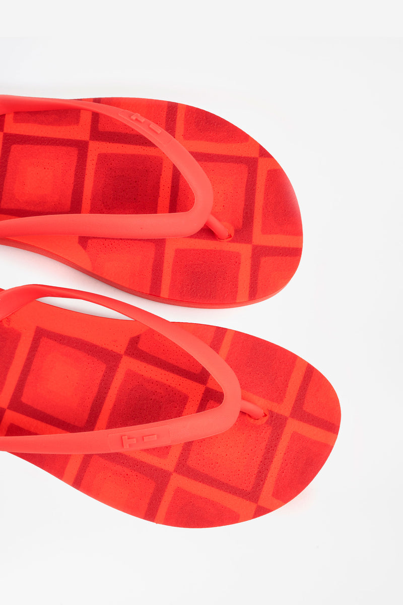 Sustainably made red flip flops. Made in America