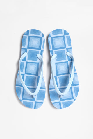Sustainable blue flip flops made from 100% American made material