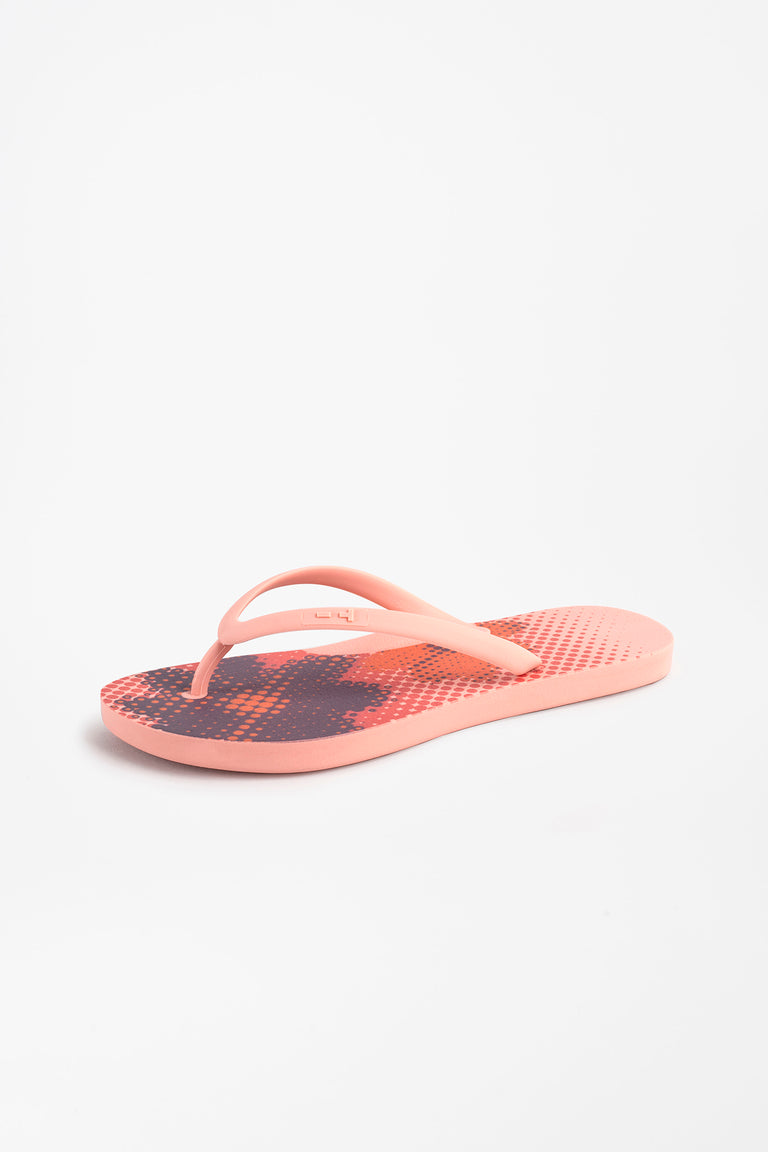 Side view of women's pink flip flops with flower print