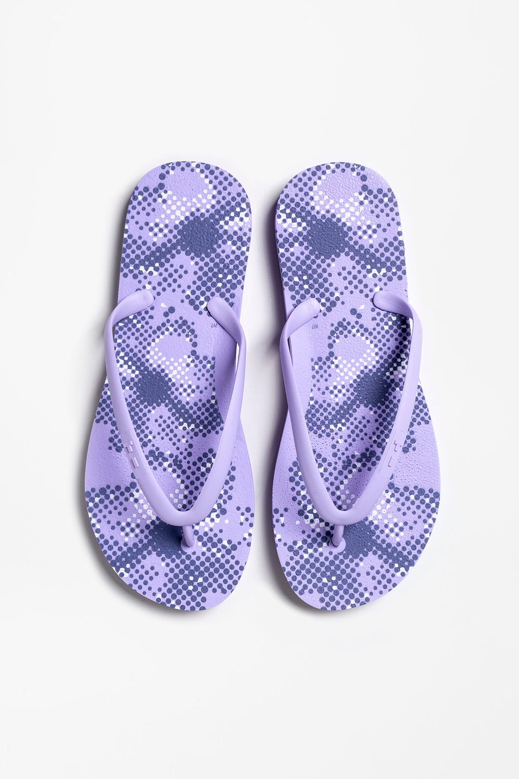 Purple women's flip flops with flower print