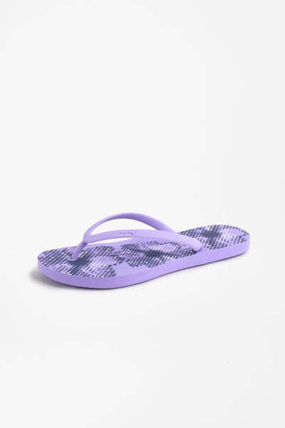 Side view of women's flip flops in purple with flower pattern