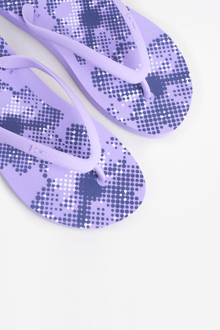 Womens purple flip flops with flower pattern