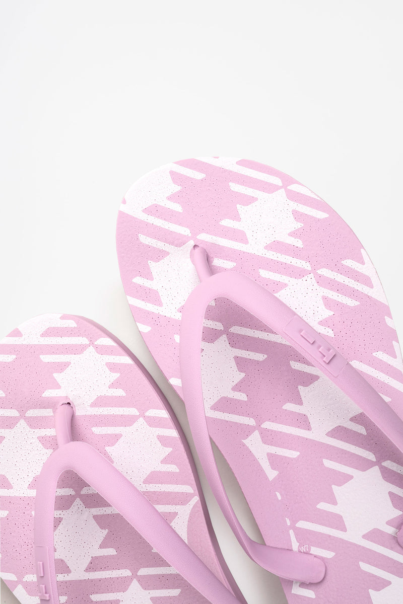 Women's comfy pink flip flops with white check pattern