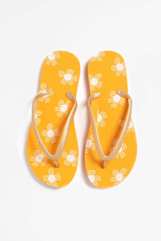 Women's orange floral flip flops, made in America from Tidal NYC