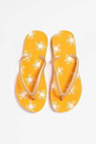 Women's MIA orange flip flops with white flower design. Shop now