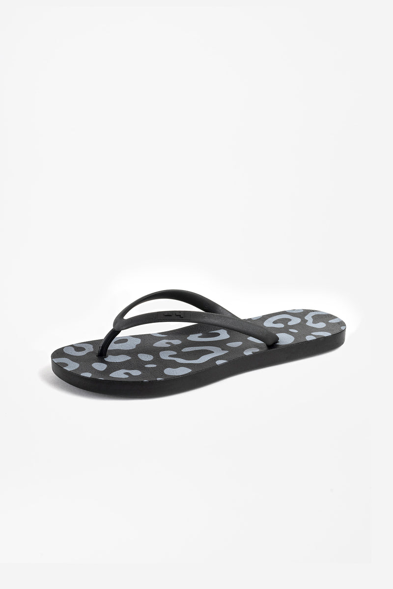 Side of view of women's flip flops in black with light grey animal print