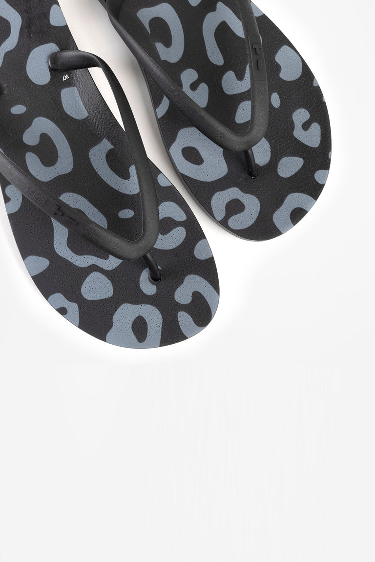 Eco-friendly women's black flip flops with animal print pattern