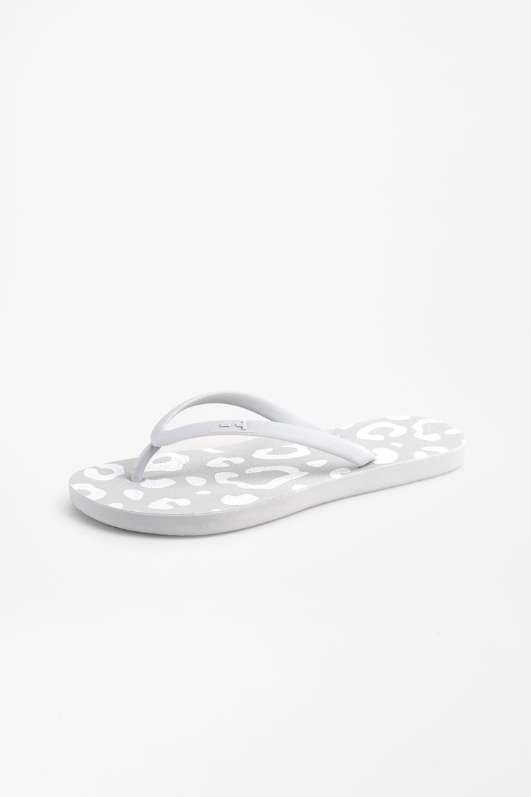Side view of light grey animal print flip flops for women