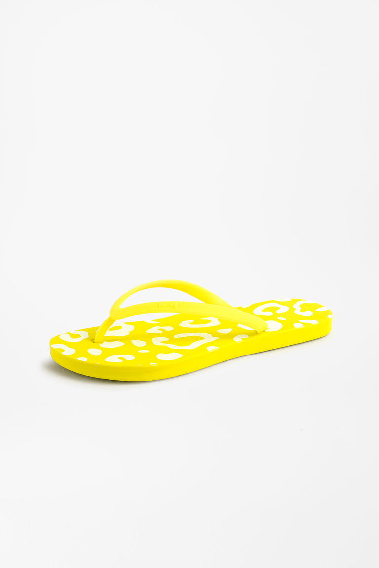 Side view of cute women's flip flops in yellow