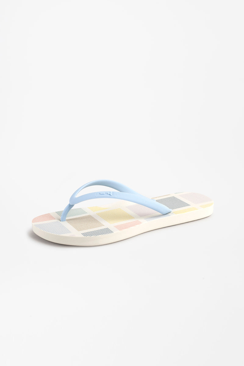 White women's flip flops with color block design
