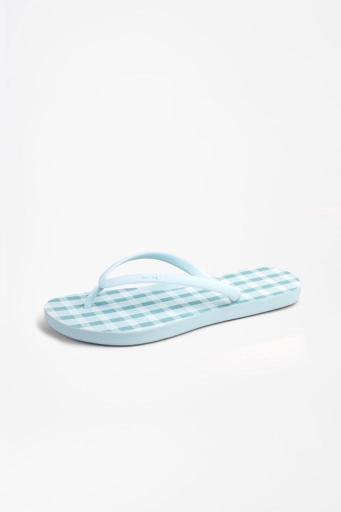 Side view of checked blue flip flops for women