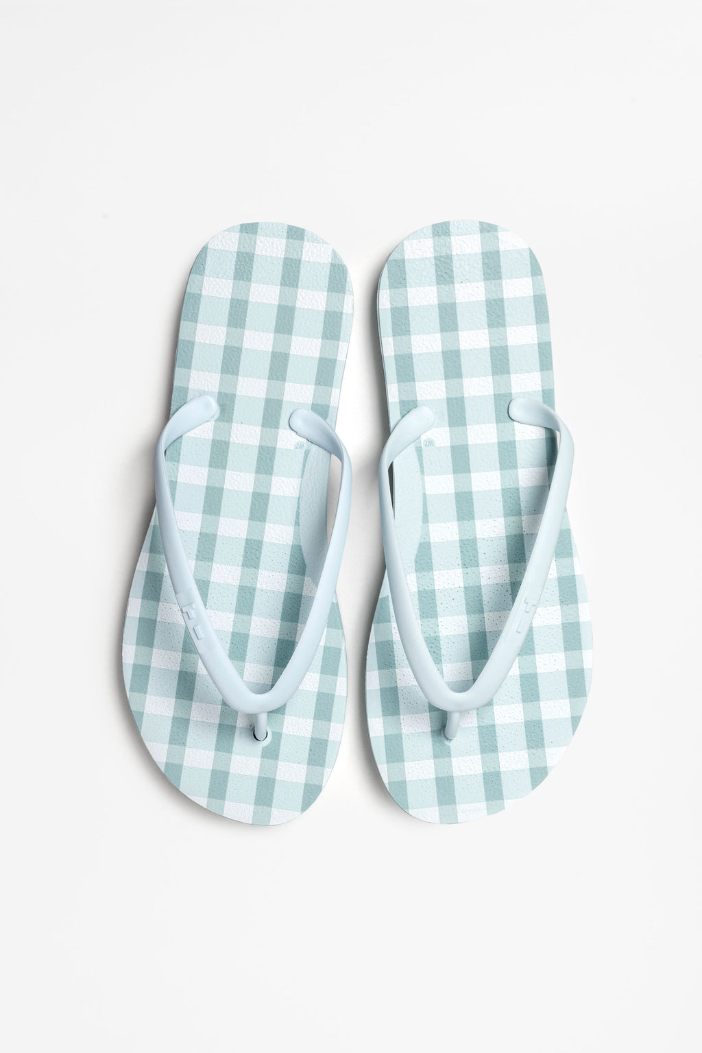 Women's icy blue flip flops with white checked pattern