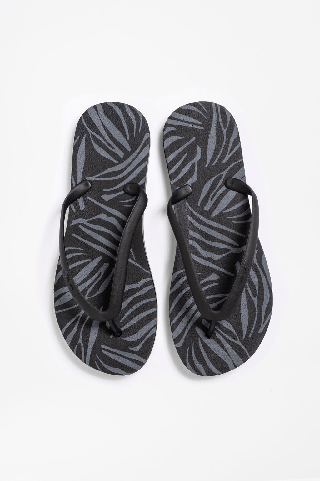 Black flip flops for women with zebra print pattern