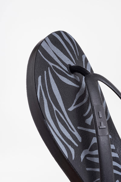 Black flip flops in zebra print design