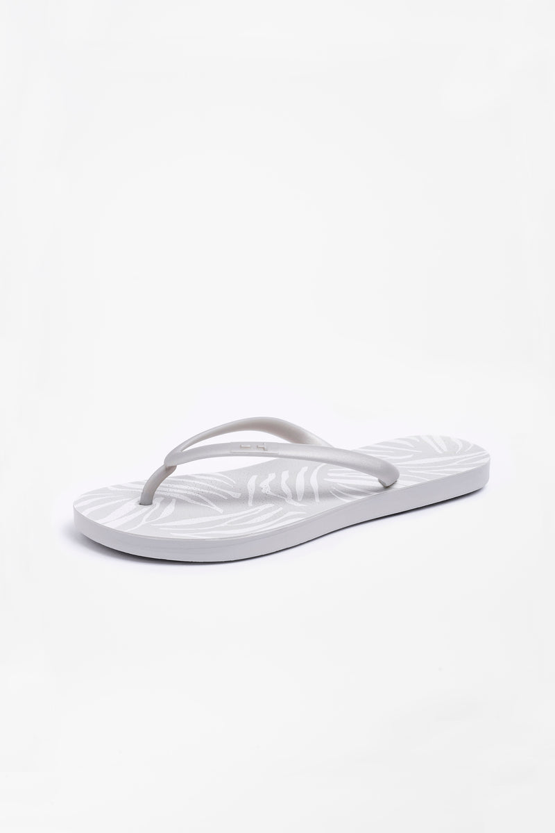 Women's flip flops in light grey with silver strap and zebra print design