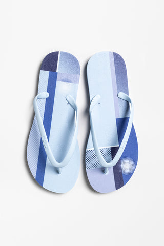 Blue flip flops for women with color block print design
