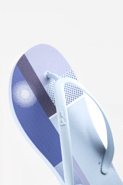 Sustainable blue women's flip flops made by Tidal New York
