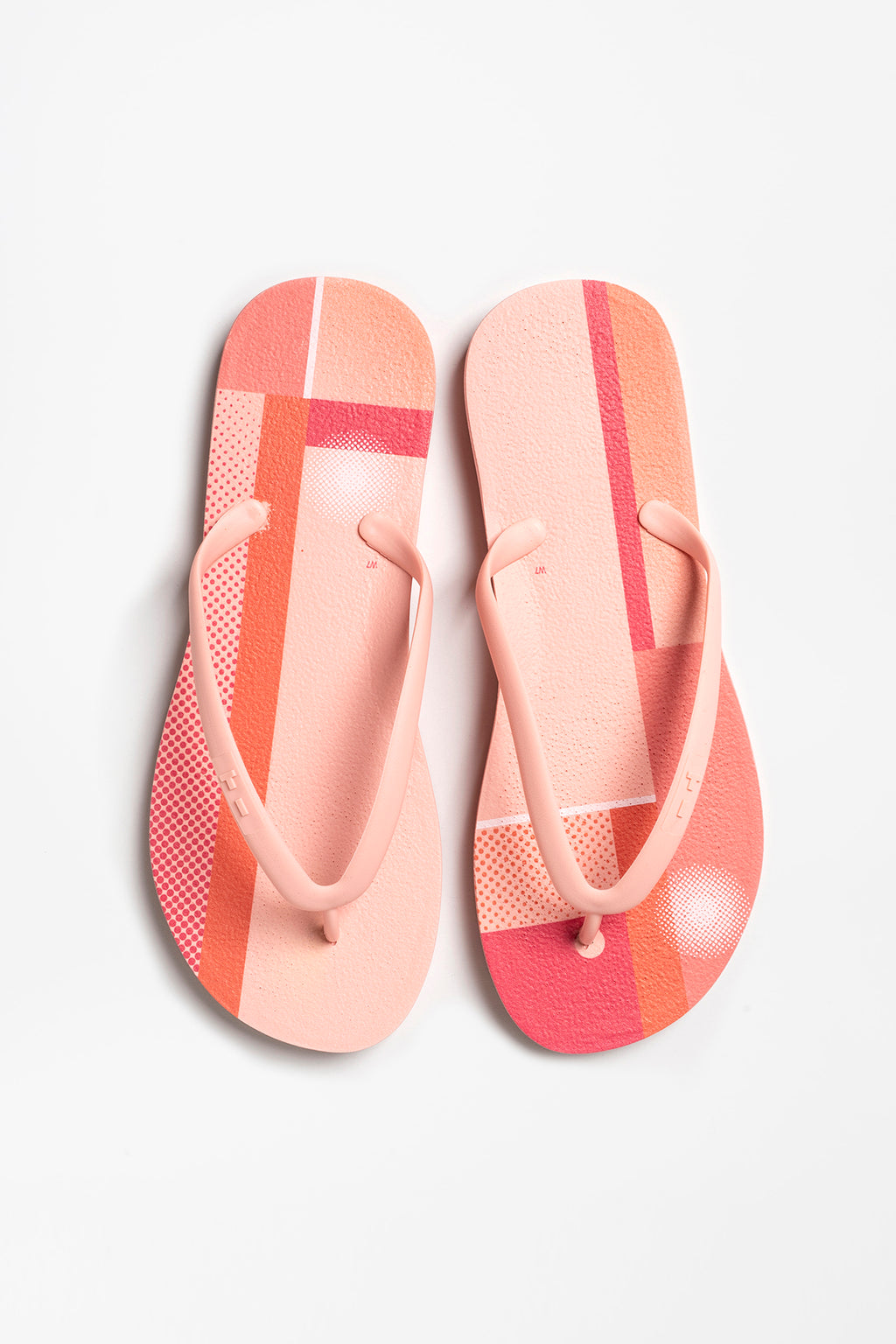 Women's pink flip flops with color block print pattern