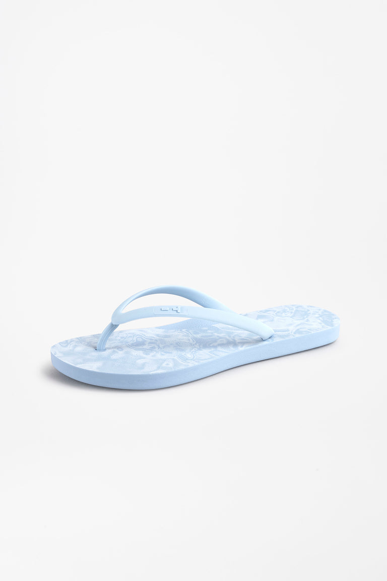 Side view of blue women's flip flops with wave pattern in white