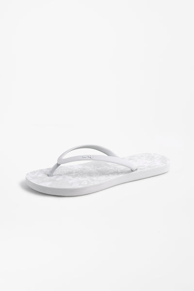 Women's flip flops in light grey with white wave pattern design