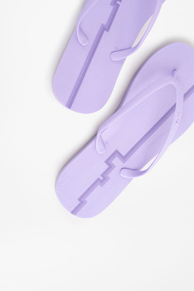 Striped purple women's flip flops made with recyclable materials