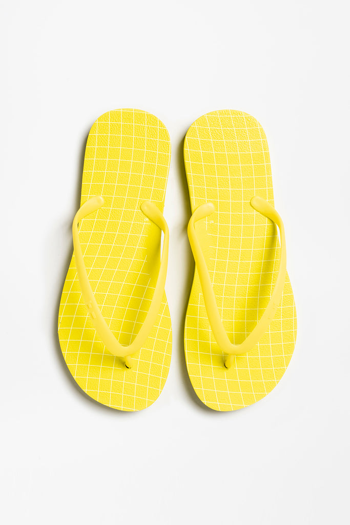 Long lasting women's yellow flip flops made by Tidal New York