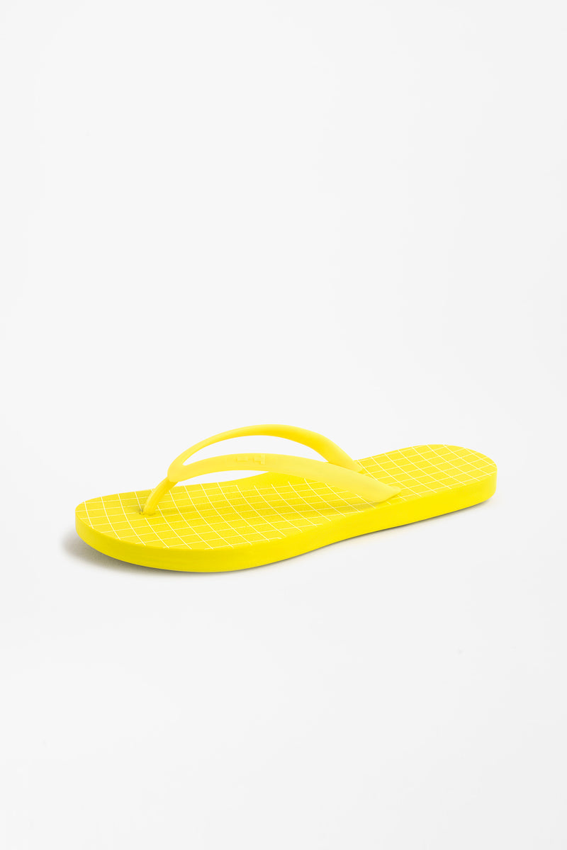 Flip flops for women in bright yellow with intricate grid pattern design