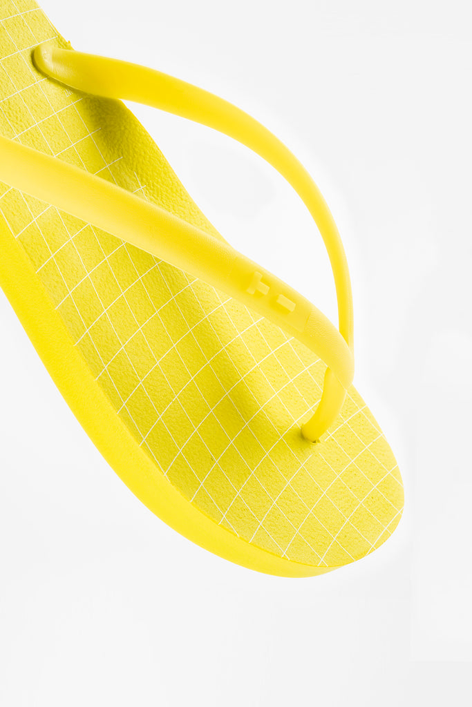 Yellow women's flip flops with white wavegrid design