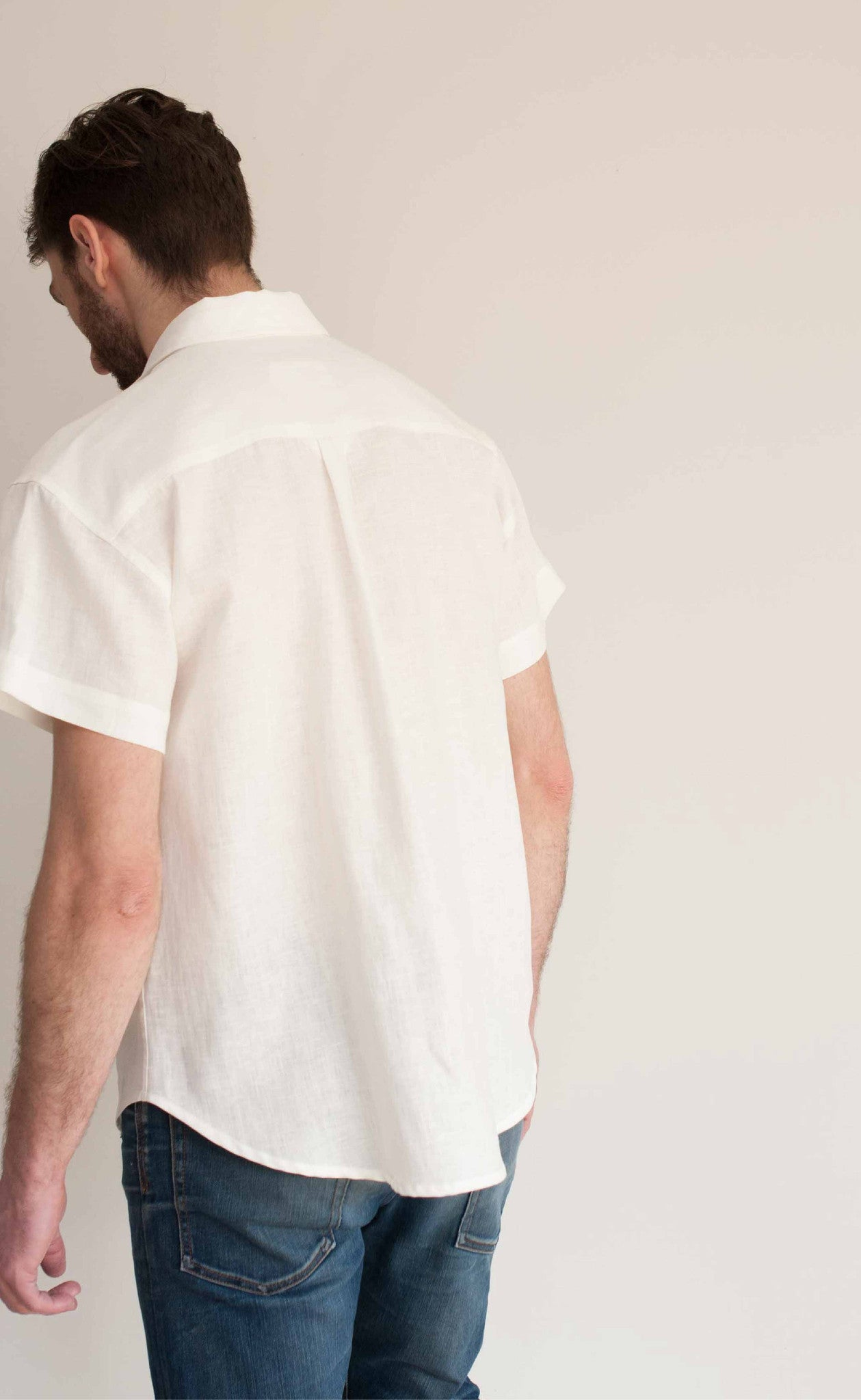 Back view of our white Linen short sleeve button-up, loose and perfect for hot days