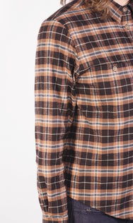 Close up view of women's workwear inspired brown and teal plaid button-up, made in Vancouver.