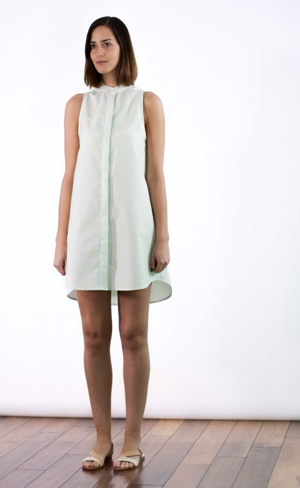Front view of mint coloured sleeveless shirt dress.
