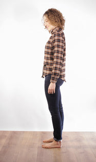 Side view of women's workwear inspired brown and teal plaid button-up, made in Vancouver.