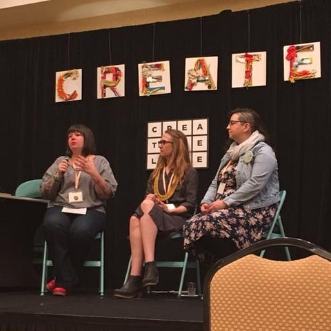 Self Care Panel with Meighan O'Toole, Lisa Anderson Shaffer, and Rosalie Gale sitting on a stage