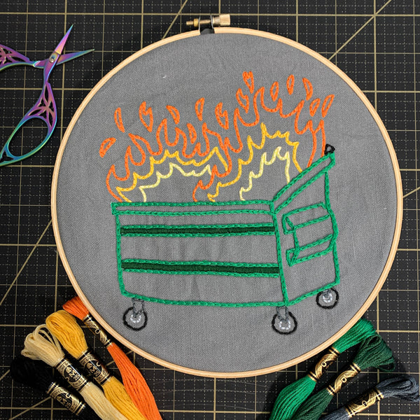 Dumpster Fire Embroidery Kit with hoop and skeins of thread and embroidery scissors