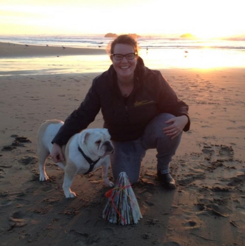 Sho Roberts on the beach with Maggie Mae, her bulldog