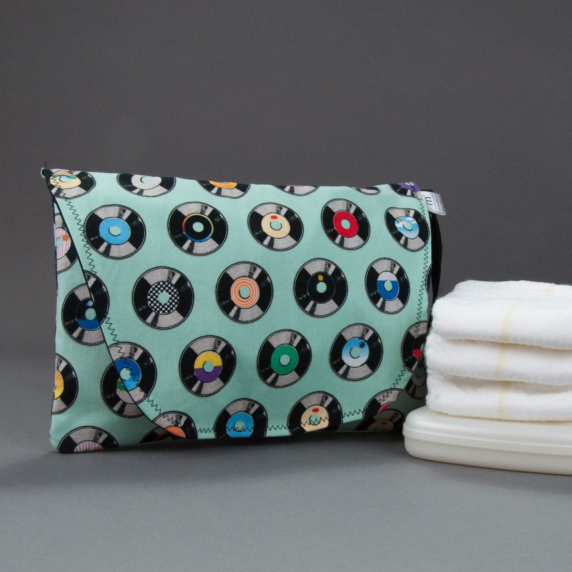 Aqua Vintage Records Diaper + Wipe Clutch, Image of an aqua diaper pouch next to diapers and wipes