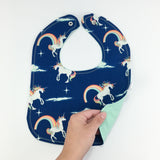 Blue Unicorns + Rainbows Bib by MarshMueller