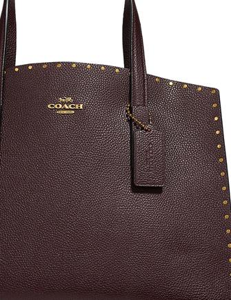 9999a7f0be Coach Border Rivets Charlie Carryall in Pebble Leather