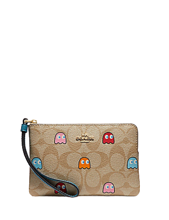 Coach Corner Zip Wristlet in Signature Print with Pac Man