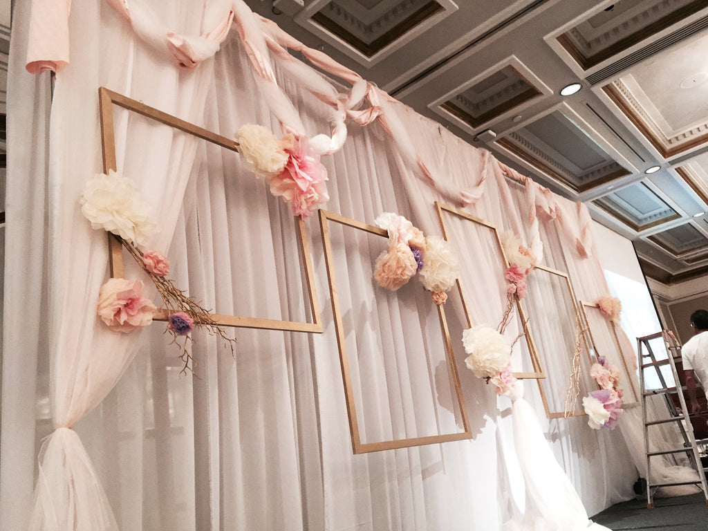 Fabric Backdrop with paper flowers and life size golden frames